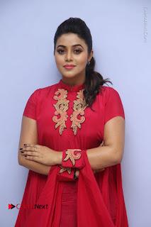 Actress Poorna Latest Stills in Red Dress at Rakshasi First Look Launch  0027.JPG