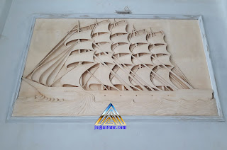 Ukiran relief kapal layar dari batu alam PARAS JOGJA / BATU PUTIH