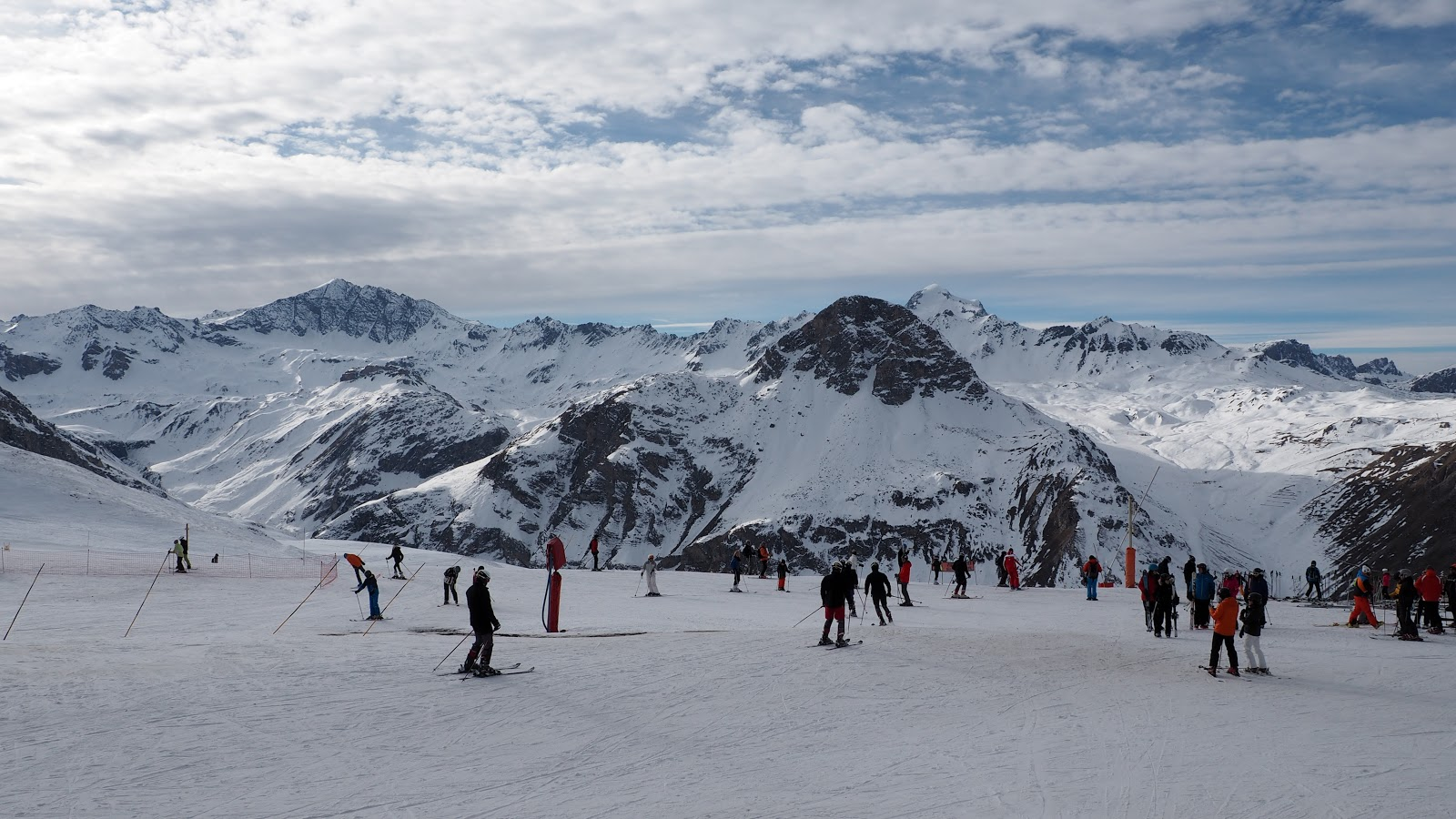 skiing on top of a snowy mountain in Val d'isere, France