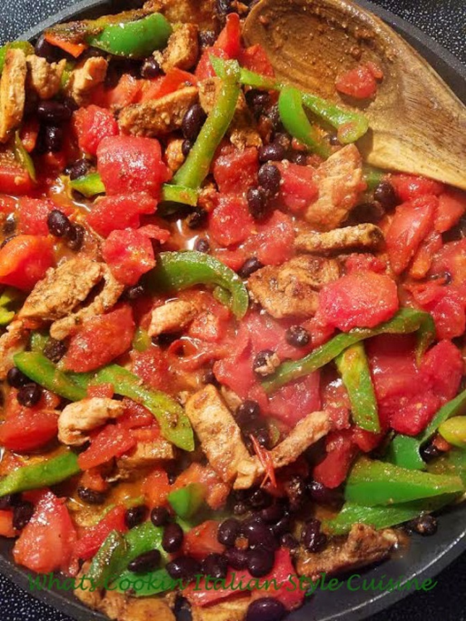 this is a pan of vegetables and meat for filling a taco or tortilla