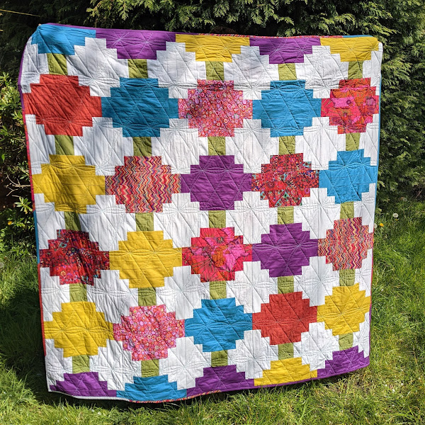 Modern traditional courthouse steps quilt with bold colours and prints
