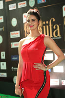 Meenakshi Dixit in Red One Shoulder Red Zipped up gown at IIFA Utsavam Award 51.JPG