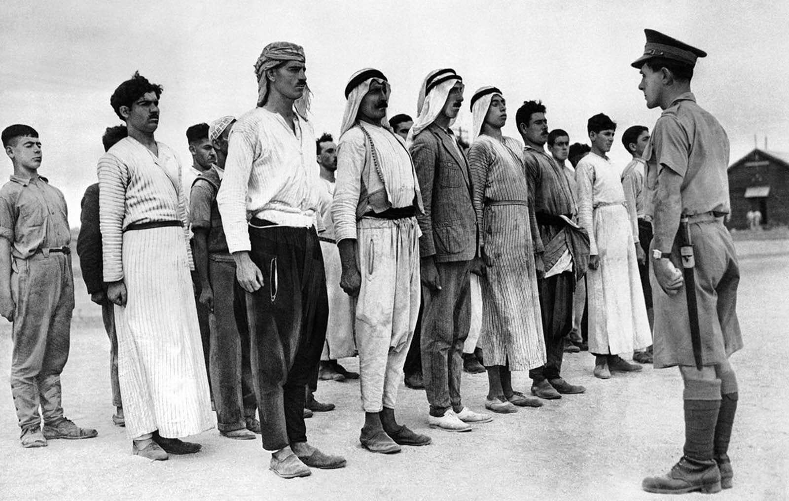These Arab recruits line up in a barracks square in the British Mandate of Palestine, on December 28, 1940, for their first drill under a British solider. Some 6,000 Palestinian Arabs signed up with the British Army during the course of World War II.