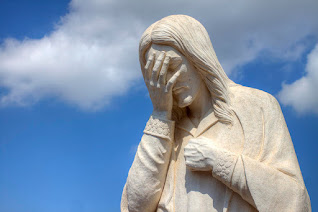 A stock image of Jesus looking ashamed