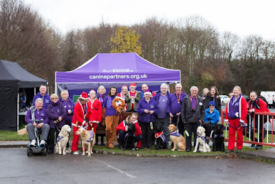 Picture of everyone in front of the Canine Partners stand