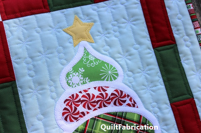 snowflake and snowball quilting on the Christmas Tree wall hanging