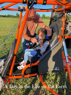 Girl being strapped into a powered parachute