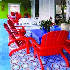 Dominican artist, Cándido Bidó is renowned for his intense colors and attention to detail. He's also the creative force behind the bold Espiral cement tile design used on this open-air patio floor.