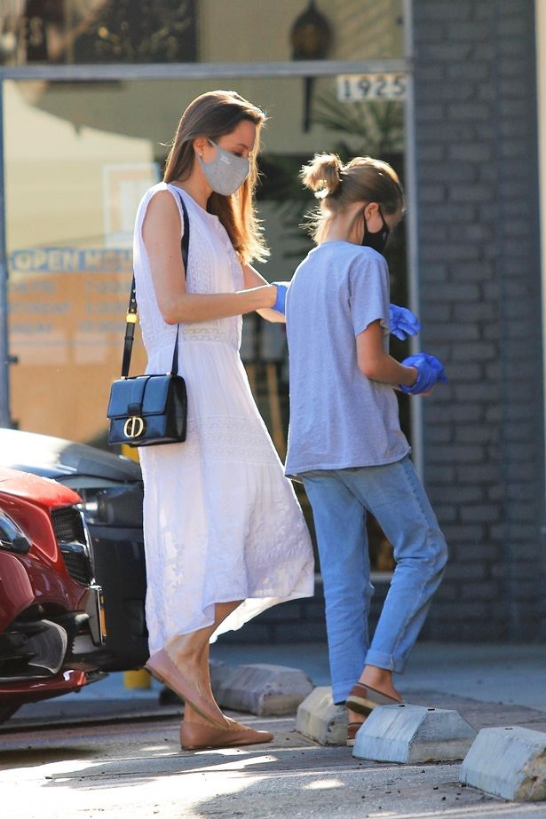Angelina Jolie seen for first time in months as she goes shopping with daughter (photos)