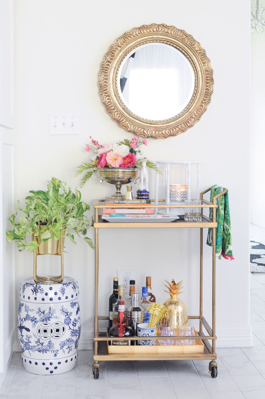 Love this gold bar cart styled with spring decor- so many great decor tips and ideas for styling a bar cart in your home.
