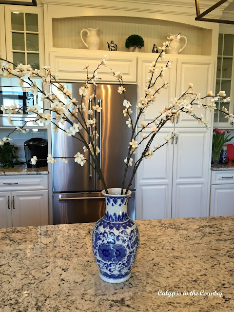 Blue and white vase in white kitchen
