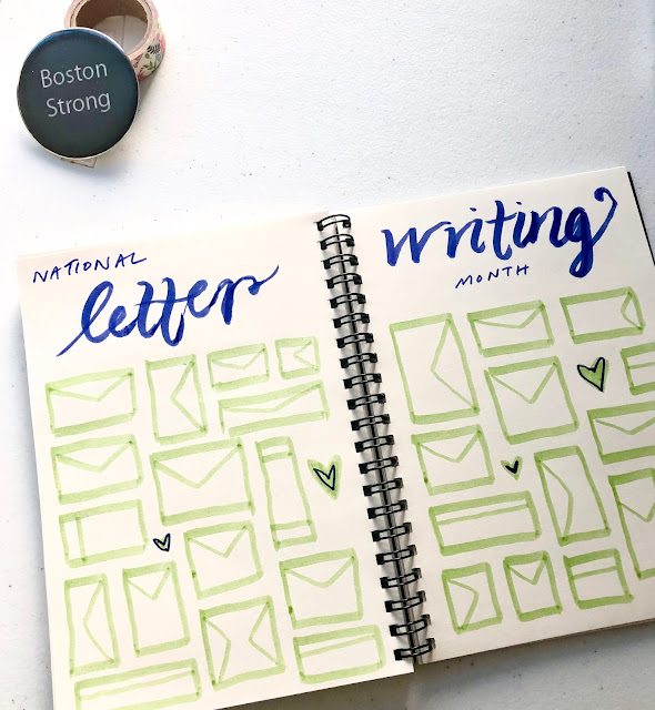 "An open notebook with ""National Letter Writing Month"" written above two pages filled with hand drawn envelopes"