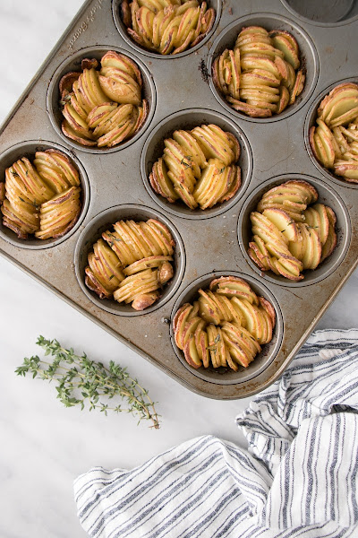 Top view of sliced potatoes in a muffin tin.