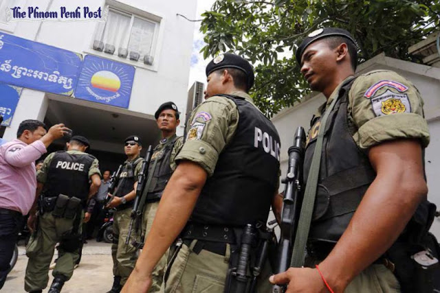 Heavily armed police wait in front of the CNRP headquarters in Phnom Penh during a search for acting opposition leader Kem Sokha in May. Pha Lina