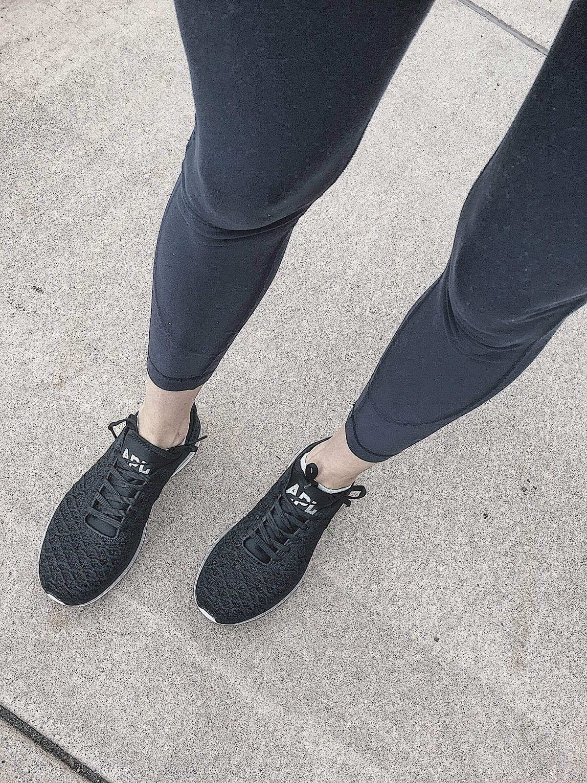 black apl sneakers and best navy workout leggings
