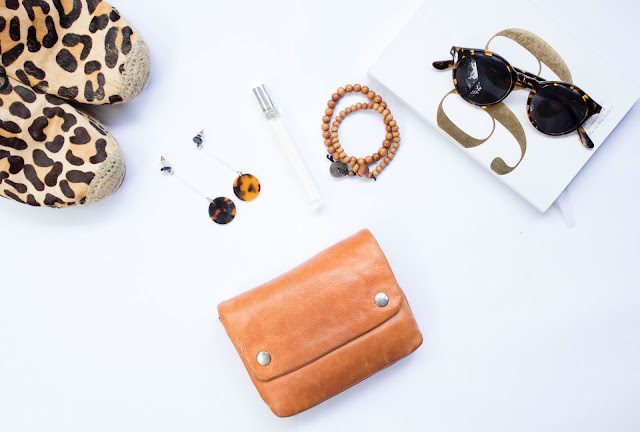 flatlay with leopard print shoes, clutch bag and jewelry.