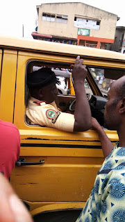 ILLEGAL ARREST | YOUNG LADY PREVENT LASTMA OFFICERS FROM ARRESTING A COMMERCIAL BUS IN IKEJA.