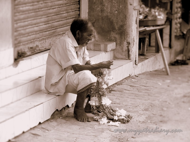 A man resting on the streets of Rameshwaram, Tamil Nadu