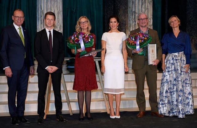Crown Princess Mary wore a white dress by David Andersen, and Paris white leather pumps by Gianvito Rossi