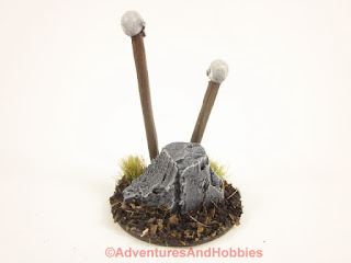 Rear view of T1582 skull totems designed for 25 to 28mm scale miniature wargames.