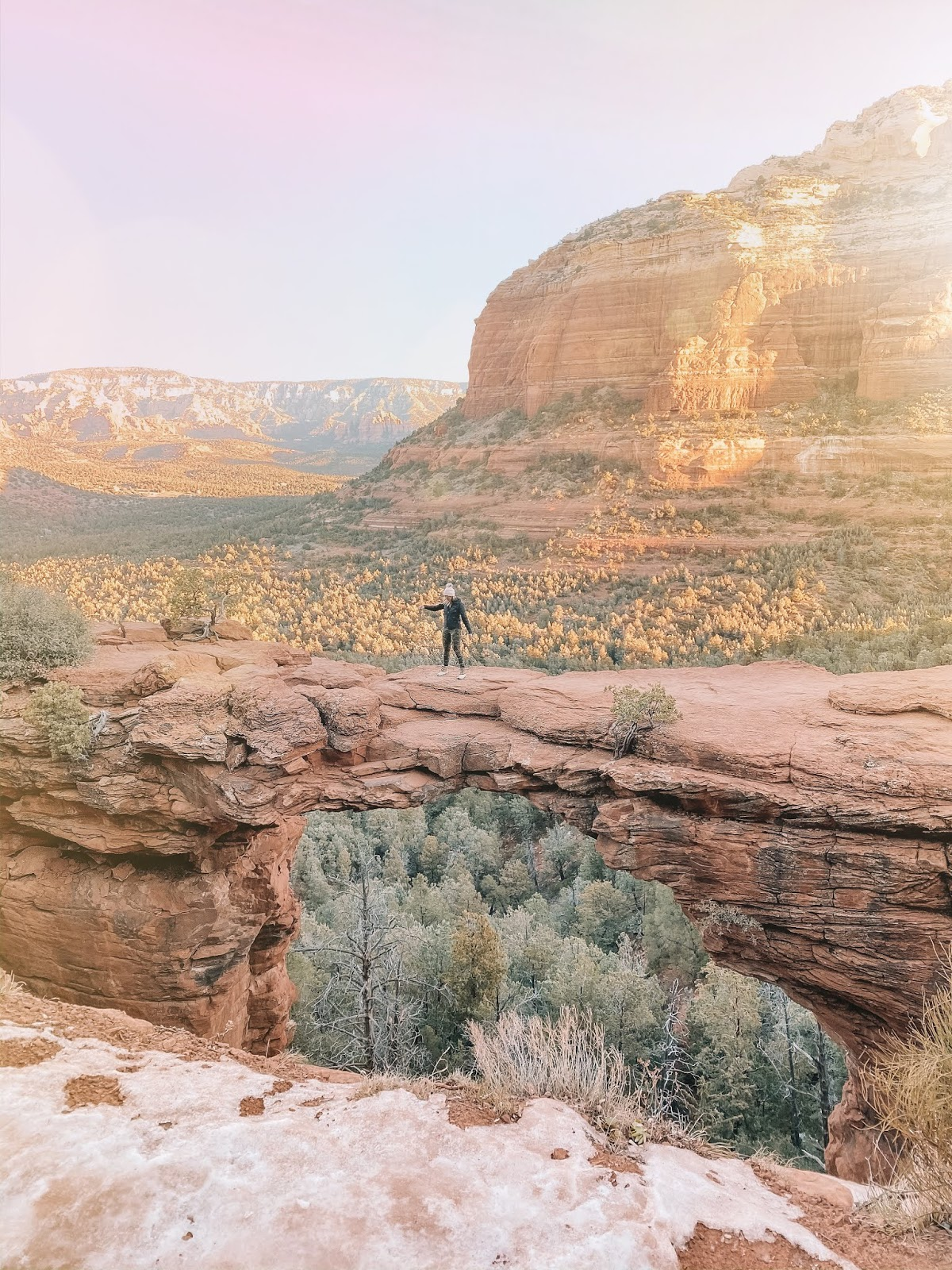 Travel blogger Amanda Martin crossing Devil's Bridge in Sedona Arizona