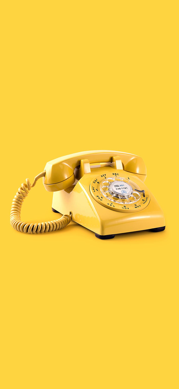 خلفية هاتف بقرص قديم أصفر