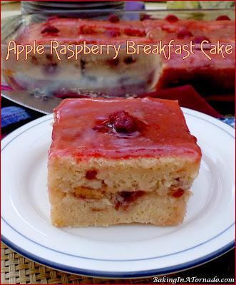 Apple Raspberry Breakfast Cake is a delicious breakfast or snack cake made with chopped apples, swirled with raspberry jam and topped with a raspberry glaze. | Recipe developed by www.BakingInATornado.com | #recipe #cake