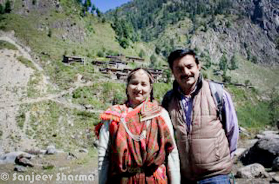 After a wonderful Photo Journey of week-long snowfall in Shimla, here is another Photo Journey by Sanjeev Sharma. Most of these photographs are clicked with Phone Camera or point-n-shoot digital cameras and tell a brilliant story about a very different & isolated place of Himachal Pradesh. Let's take off from Shimla in Helicopter and move towards Bhagal region to have an amazing Photo Journey from least explored Himachal, India...Sanjeev being a Senior correspondent in Himachal Pradesh gets some opportunities to explore some of the places in Himachal, where top politicians never thought of visiting in past. Prof. Prem Kumar Dhumal, current Chief Minister of Himachal Pradesh, thought of visiting Bhagal regions of the state to know how exactly those people live without much connectivity with other parts of the world. Above Photograph shows Sanjeev on extreme left, Dhumal(CM, Himachal) next to him and few more officers of Himachal Pradesh Government.Here is a photograph inside the government chopper, which is probably only way to reach the place to avoid the long path which may take days to reach the place. This time, whole crew is going to Bada Bhangal with Chief Minister Prem Kumar Dhumal...Sanjeev had posted this photograph on Facebook with caption - 'for historic voyage to most beautiful as well as underscored area of Himachal Pradesh'On reaching the marvelous place, we met lot of humble people of Bada Bhagal. Here is a photograph on the shores of ravi river with Bada Bhangal village in backdrops... We are sure that you might have noticed unique styled dressing of these people. Since this region is not very well connected and  very cold, these dresses are still preferred by folks of Bada Bhangal. Silver Jewellery is still preferred over Gold Jewellery, Siver is considered as very auspicious as per some of the old mythologies. There may be some other economical or geographical reasons associated, about which we are not aware of.Here is another Photograph of Mr. Sanjeev Sharma with Bhangal beauties in Chhota Bhangal regionThis was probably first time, when any Chief Minister thought of visiting the place. Most of the Bhagal folks don't contribute much to Democracy of Himachal Pradesh or our country. Since this is an isolated area, most of the folks avoid their duties in this region. Even if they reach, folks in Bhagal are not very much aware or interested in selecting a representative. IF elections are in Winters, no one will be there in Bhagal Villages of Himachal Pradesh.Here is a photograph of Bada Bhangal Village in Himachal Pradesh, India. Mr. Prem Kumar Dhumal, Chief Minister of Himachal Pradesh visited Bhagal region an did some promises to provide more infrastructure to this region, so that they and their cattle can live a better life. Usually these people are wealthy as each family is owner of hundreds of cattle and farms... At the same, we want to know more about their routine life which can help in better understanding the way they think and how it make them different from rest of the worldKids of Bada Bhangal performing in traditional styled Folk-Dance with amazing dresses with lots of colors, woolens and local productions...'Dhudu Nachya Jattan o Khalari bo...''Chehre ki jhurriyon main jeevan ka saransh...the bhangaloo ladies..' - A Caption by Sanjeev Sharma, while he shared this photograph on Facebook. A Lovely photograph of old lady from Bhagal region of Himachal Pradesh. She has both sides of nose pierced, which is rare. Although many folks in urban region do such things but this is one of the old traditions of Bhagal Region. Although new generation of Bhagal has left this one. Even this lady is wearing relatively very small sized jewellery, as old ornaments used to cover both sides of the noseCute children of Bhagal Region of Himachal Pradesh with lovely smile on their faces, when they are dressed up for performances in front of Chief Minister of Himachal Pradesh - Mr. Prem Kumar Dhumal.While reading more about Bhagal region of Himachal Pradesh, we found that it's also popular destination among trekkers and Adventure Lovers because this region is considered as virgin mountains of Himachal Pradesh. While at the same time, this reason is problematic for residents of Bhagal region.The alpine terrains between the Kullu Valley/Manali and Dharamshala is one of the most spectacular and little known regions of the West Himalaya. Trails crossing verdant meadows (with excellent campsites) and traversing snow bound passes to access secluded Hindu villages and remote shepherd encampments are the key attractions of this unique trek. This is a trek for the 'Himalayan hand', with an opportunity to absorb unrivalled views of the Pir Panjal, Bara Bhangal and Dhar Dhaula Dhar ranges before descending to the Kangra Valley and Dharamshala -the seat of the 14th Dalai Lama and his Tibetan government in exile. (Check out following link to know more about Trekking Opportunities in this region - http://www.trekkinginindia.com/trekking-in-himachal/bara_bhangal_trek.html)Most of the shepherd communities live in Bhagal Region, who leave this place during winters and go away with their cattle to lower Himachal Regions. They keep everything back in their homes and make sure that all the stuff is better packed to keep them safe from Storms, Snow, rains and other weather related calamities. Since these regions are not well connected with other parts of the state, they have move on feet and some of the old folks, who can't walk need to remain there. Which is one of the sad part of Bhagali folks. Although Government has made sure that basic facilities are available in these regions, but service providers (employees) don't prefer to come to these regions. E.g.- Region has schools, dispensaries but it's hard to get good teachers or doctors in this region. There are very few Bhagal folks, who are educated enough to get jobs in these schools and Dispensaries.Here Sanjeev is trying their traditional Music Instrument...In Bhagal Region, when folks come back  during beginning of summers they stop at the distance of 5-10 kilometers from their village. One person from the group go inside the Village to check the conditions of the houses, people who were living there during winters. At times, they get a news that some of them have died and whole group enter into the village with their tears and cry. All things are settled as a group and they continue their life of summers at home and again start the journey during beginning of Winters. It's really strange to know about the typical life of folks from Bhagal region of Himachal Pradesh. Finally a question comes in mind that what is the motivation for these people, so that they keep traveling to fight with weather conditions and lose the joy of their lives. Their children rarely get education. Only few of them complete Graduation etc. Anyways, this is how Bhagal continues to relive every year with very strange traditions, which are completely different from rest of the world.Thanks a Lot Sanjeev for sharing so much about this region of Himachal Pradesh, India !!!As a trekker, you can see more details about Bhagal Treks at - http://www.trekhimachal.com/newsite/places/bada-bhangal