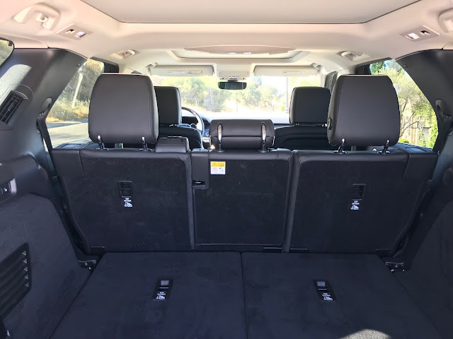 View from rear cargo area forward in 2019 Land Rover Discovery HSE Luxury