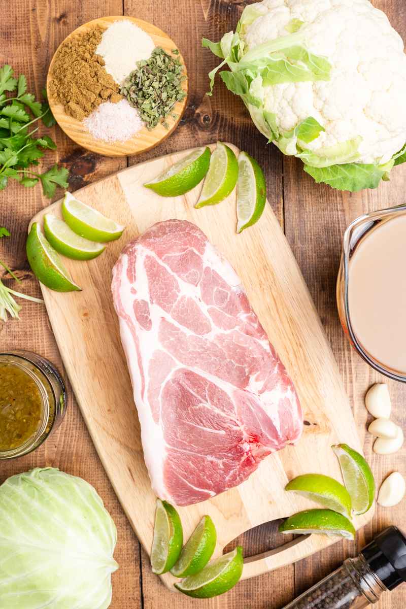 Ingredients needed to make Keto Pork Pozole Verde on a wooden table.