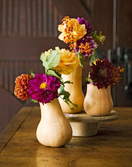 These flower vases made from squash are creative centerpieces.