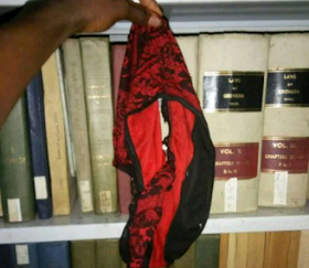 Man holding a red and black underwear