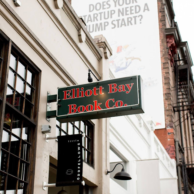 Picture of Elliott Bay Book Co. store sign from the sidewalk