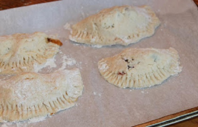 This is homemade pie dough filled with pumpkin filling and made into turnovers