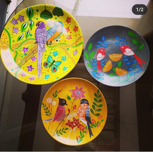 Bright birds on handmade wall plates