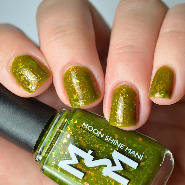 green jelly nail polish with flakies swatch