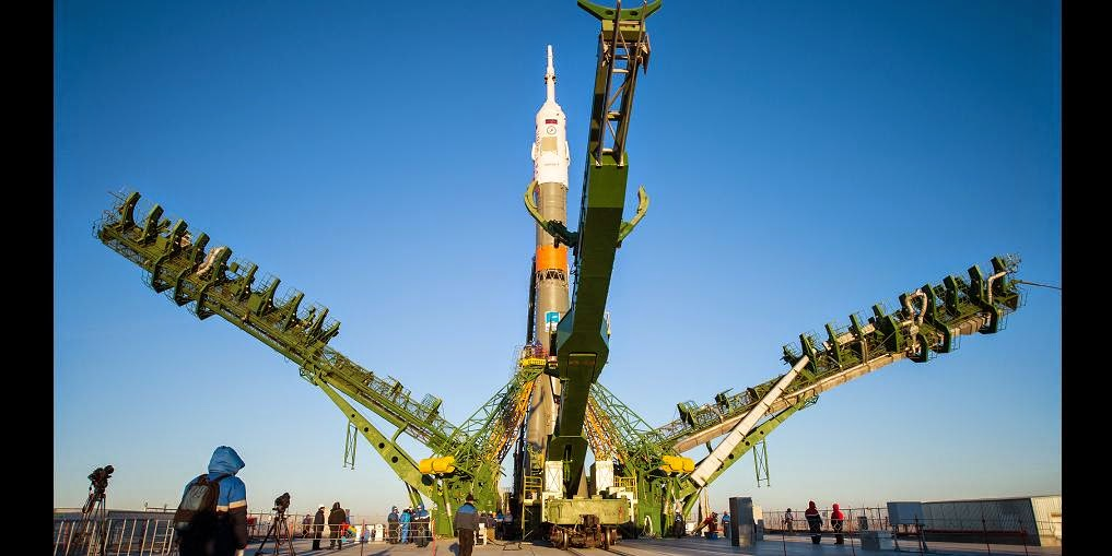 The gantry arms close around the Soyuz TMA-15M spacecraft to secure the rocket at the launch pad on Friday, Nov. 21, 2014 at the Baikonur Cosmodrome in Kazakhstan. Launch of the Soyuz rocket is scheduled for Nov. 24 and will carry Expedition 42 Soyuz Commander Anton Shkaplerov of the Russian Federal Space Agency (Roscosmos), Flight Engineer Terry Virts of NASA , and Flight Engineer Samantha Cristoforetti of the European Space Agency into orbit to begin their five and a half month mission on the International Space Station. Photo Credit: (NASA/Aubrey Gemignani)
