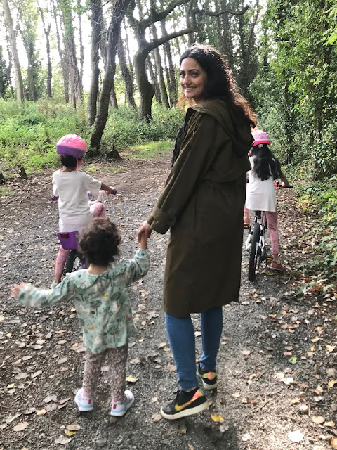 amina walking with her children in the woods