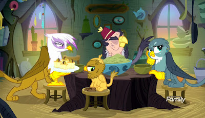 Gilda, Grandpa Gruff, Gabby and an unnamed baby griffon look glum as they sit around a rough table