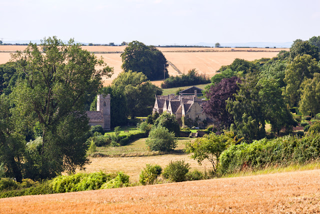 Asthall Manor and church on the Cotswold countryside by Martyn Ferry Photography