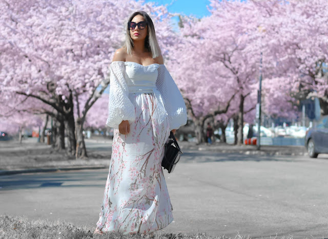 white off the shoulder top with cherry blossom print skirt