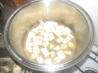 Cooking yam pepper soup for nursing moms
