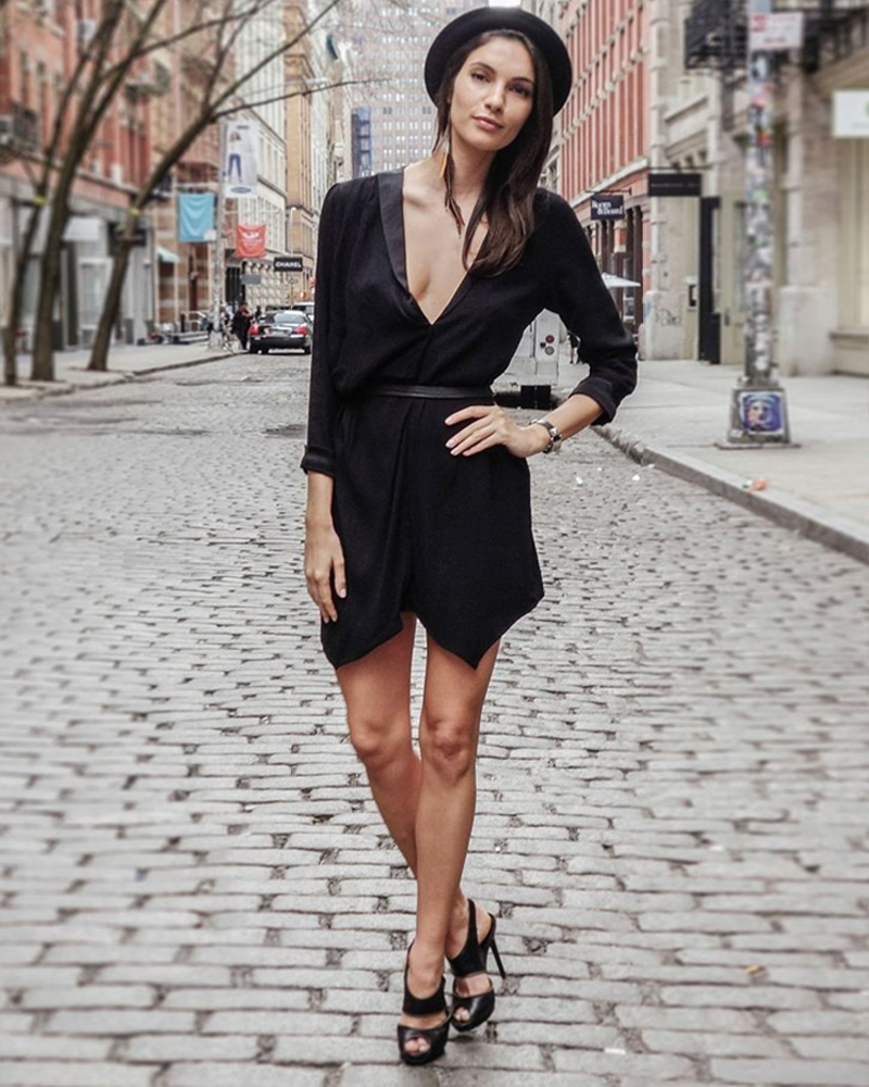 Teresa Moore in Black Jumpsuit with Low V Neck