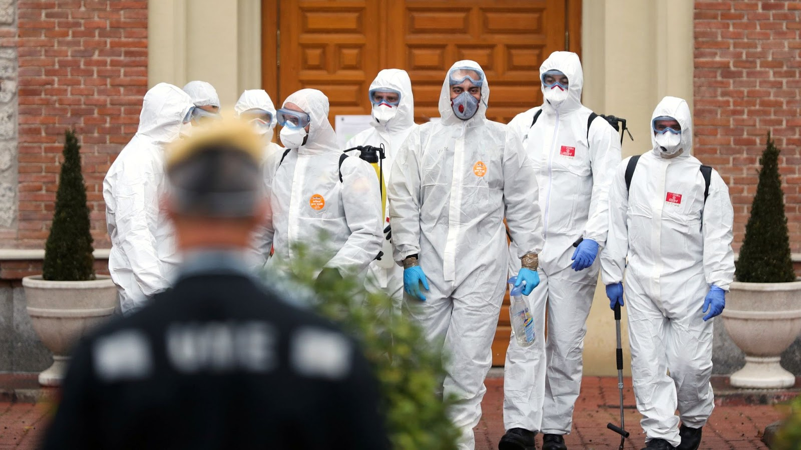 Members of the Military Emergency Unit leave an elderly home in Madrid after carrying out disinfection procedures