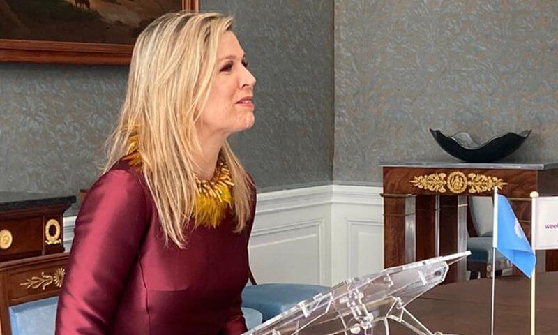 Global Money Week 2021. The 10th edition of the Money Week. Queen Maxima wore a burgundy red satin dress from Natan, red cape coat from Valentino