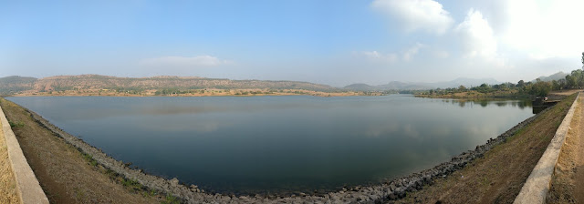 dam backwaters surrounded by beautiful golden grass with green patches