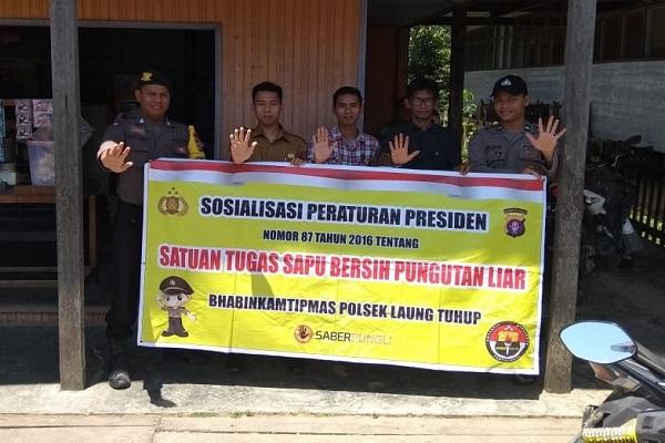 Cegah Pungli, Bhabinkamtibmas Sosialisasi Peraturan Presiden Nomor 87 Tahun 2016 di Muara Tuhup