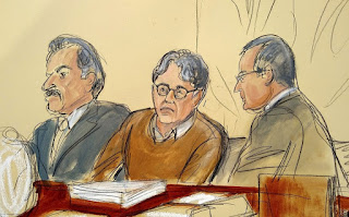 In this courtroom drawing, convicted sex-cult leader Keith Raniere, center, is seated between his attorneys Paul DerOhannesian, left, and Marc Agnifilo during the first day of his sex trafficking trial on May 7, 2019. (Elizabeth Williams via AP)