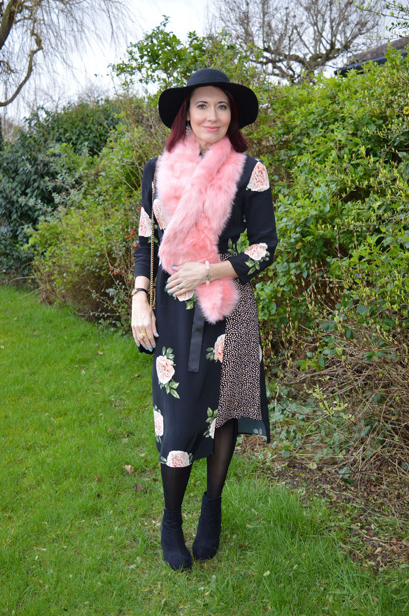 A pink and black floral print dress worn by Emma Peach from Stylesplash