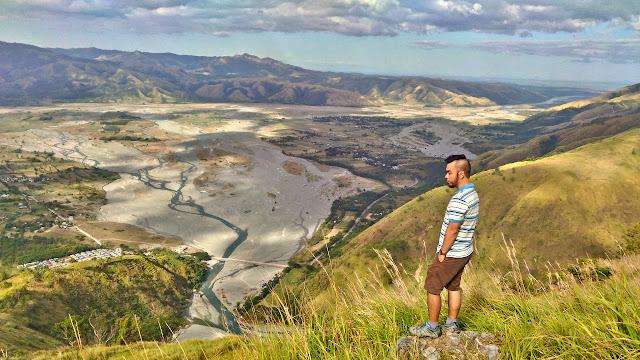Marky Ramone Go stands atop Mount Sawi Gabaldon Nueva Ecija